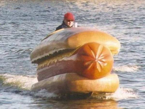 Phil Hellmuth Rides Giant Hotdog in Water