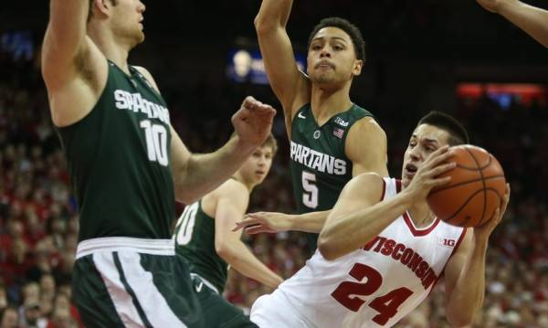 What is the Line on the Wisconsin Badgers vs. Michigan State Spartans Game March 16